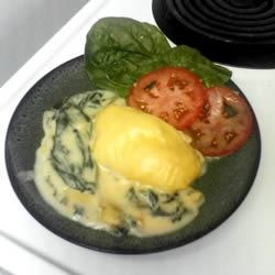 Halibut Florentine Recipe - Halibut in a cheesy sauce over spinach. This is SO easy and the halibut comes out moist and flaky. Great for company because it's fancy but simple to make!