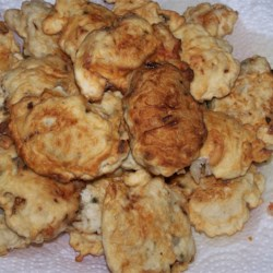 Cucur Udang Recipe - Tasty and exotic, these Malaysian shrimp fritters are easy to prepare. Fresh shrimp, chives, onions and bean sprouts are mixed into a flour and water batter and fried by the spoonful in oil. Enhance with a spicy chili sauce, if you wish.
