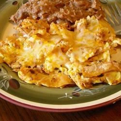 Chilaquiles II Recipe - Fried tortilla chips are cooked with eggs, salsa, and cheese. Don't wait to try this Mexican favorite!