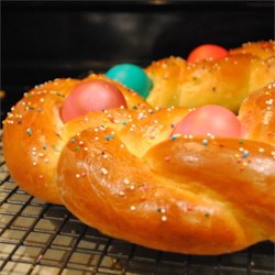 Braided Easter Egg Bread Recipe - A rich, white yeast bread is braided and decorated with in-the-shell raw eggs before baking. The eggs cook right along with the bread, and if the eggs are dyed beforehand, they add a particularly festive touch to the finished bread.