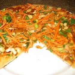Thai Chicken Pizza with Carrots and Cilantro Recipe - Peanuts, chicken, and cilantro lend a Thai twist to this easy pizza!