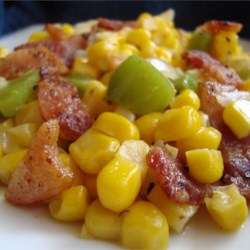 Skillet Fried Corn Recipe - Corn, green peppers, and onions are fried with bacon for an easy and delicious side dish.