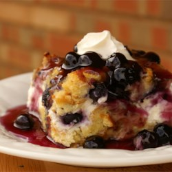 Overnight Blueberry French Toast Recipe and Video - This is a very unique breakfast dish. Good for any holiday breakfast or brunch, it's filled with the fresh taste of blueberries, and covered with a rich blueberry sauce to make it a one of a kind.