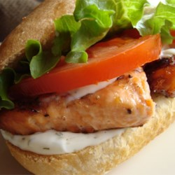 Grilled Salmon Sandwich with Dill Sauce Recipe - This sandwich features grilled salmon, bacon, lettuce, tomato, and a simple sauce of dill, lemon zest, and mayonnaise.