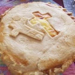 Easter Meat Pie Recipe - This meat pie is a winner every Easter. Stuffed full of ham, salami, and prosciutto, as well as ricotta, Parmesan, and mozzarella cheeses, this pie really satisfies!