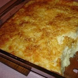 Cheesy Potato Casserole Recipe - This quick to assemble main dish is comprised of frozen hash browns, a mushroom soup middle layer and a rice cereal topping.