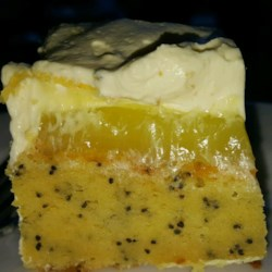 Lemon Poppy Seed Dessert Cake Recipe - This cake is cool, refreshing, light and lemony! Made easy with cake mix and instant pudding, a lemon poppy sheet cake is topped with lemon pie filling and then with a fluffy layer of lemon mousse.