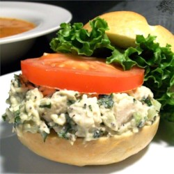 Parmesan and Basil Chicken Salad Recipe - The heady aroma and taste of sweet basil defines this cold chicken salad tossed with Parmesan cheese and dressed with a puree of mayonnaise, basil, garlic and celery.