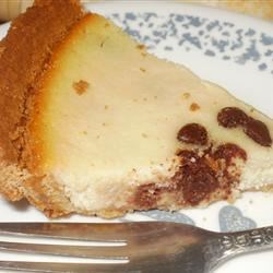 Italian Cheesecake II Recipe - This is a sweet, moist chocolate chip cheesecake with a hint of citrus and anise flavors.  It is made with ricotta cheese instead of cream cheese.