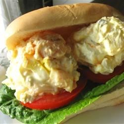 A Potato Salad Sandwich Recipe - A delicious portable lunch that you may not have thought of - potato salad on a bun! Garnish with tomato slices and lettuce, and presto, lunch!