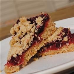 Cranberry Oat Bars Recipe - These little bars are great to snack on, are perfect at holiday time, and would be excellent for a cookie exchange.  If you have leftover dough after forming the bars, don't worry, I find that the thinner the crust, the better.