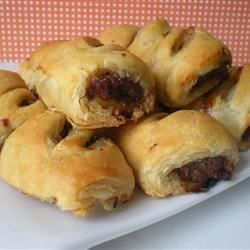 Sausage Rolls Recipe - Sausage and mustard (hand-in-hand standards),  forgo the bun here; instead, they're encased in pie crust and sliced into pretty pinwheels.