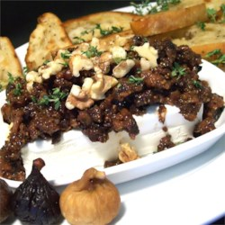 Fig and Olive Tapenade Recipe - This is an easy gourmet appetizer. I've brought this to several parties and it is always a hit! I often add some chopped green olives to the olive mixture and a little more balsamic. Goat cheese may also be used in place of the cream cheese. Serve with slices of French bread or crackers.