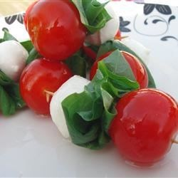 Caprese on a Stick Recipe - Serve your Caprese salad on toothpicks for a fun, easy appetizer. It takes just a few minutes to thread mozzarella balls, cherry tomatoes, and fresh basil leaves onto the picks and drizzle with olive oil.