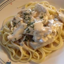 Slow Cooker Italian Chicken Alfredo Recipe - Slow cooked chicken is cheesy, creamy, and fantastic when served over hot spaghetti.