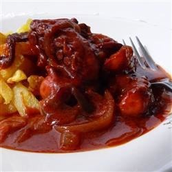 Octapodi Kokkinisto (Greek Octopus in Tomato Sauce) Recipe - Octopus is an incomparable treat. I love it grilled, in a salad, or in tomato sauce. For many, cooking octopus may seem daunting - but I assure you, it couldn't be easier. Serve this dish with hand-cut french fries or with rice.