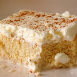 Tres Leches (Milk Cake) Recipe and Video - This light and fluffy tres leches cake recipe uses four types of milk and is topped with whipped cream, making it extra moist and delicious.