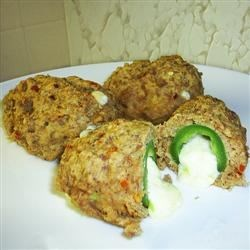 Armadillo Eggs Recipe - Cheese-stuffed jalapeno peppers are stuffed inside cheesy, spicy biscuits!