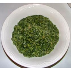 Restaurant-Style Spinach Casserole Recipe - This spinach side dish is made on the stove top.  Diced onion is mixed with chopped spinach, butter, seasonings and a can of cream of celery soup and allowed to thicken while stirring over medium heat.