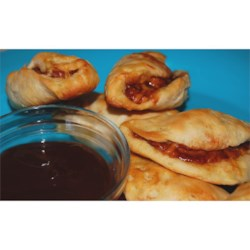 Justin's Favorite Smokies Recipe - If you like pigs in a blanket and cocktail weenies, this is the recipe for you!  Barbeque sauce and cheese add a tantalizing twist to the mix.