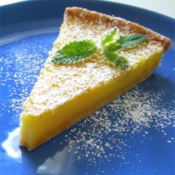 Tart Lemon Triangles Recipe - Lemon bars with both lemon juice and lemon zest, baked in a pie plate. Garnish with whipped cream and strawberries, if desired.
