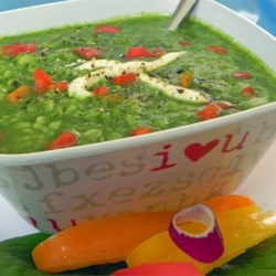 Jade Garden Soup Recipe - A savory combination of spinach, lettuce, and parsley are pureed with rice, not cream, in this cool jade green soup. Garnish with sour cream, paprika, and dill.