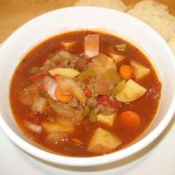 Vegetable Beef Soup II Recipe - A soup of ground beef and stewed tomatoes simmered with onions, carrots, potatoes and celery in beef bouillon seasoned with thyme, bay leaf, and basil.