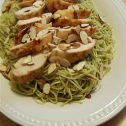 Grilled Chicken and Angel Hair Pasta Recipe - For a fast but fabulous meal, toss chunks of grilled chicken into hot olive oil, fragrant with sauteed garlic. Then add delicate strands of angel hair pasta, a big dose of your favorite pesto and top with slivers of toasted almonds.