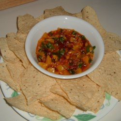 Chipotle Peach Salsa with Cilantro Recipe - I came up with this fresh-tasting, spicy recipe one night as we fired up steaks smothered in a smoky hickory BBQ sauce on our new grill. The combination was a hit and this has definitely become a new favorite. We like our food spicy, so adjust the amount of chipotle and onion to suit your taste.