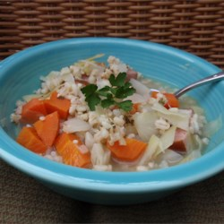 Cabbage Soup II Recipe - This is a hearty soup made with ham, barley and shredded cabbage cooked in chicken broth.