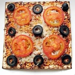 Kid's Favorite Passover Pizza Recipe - Transform sheets of matzo bread into quick and tasty pizzas with a spread of marinara sauce, a dash of garlic salt and dried oregano, and a sprinkling of cheese, tomatoes and olives. Bake until bubbly and serve.