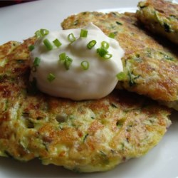 Zucchini Patties Recipe and Video - Get out your grater or food processor, you'll need to grate up a bunch of zucchini. But this is what makes these patties fry up so wonderfully. A nice change from potato pancakes. Serve with a bit of tomato sauce or sour cream dabbed on top.