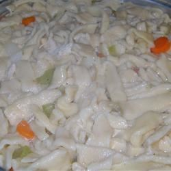 Grandma's Butter Noodles Recipe - This is my late mother-in-laws recipe for noodles -- her favorite for flavor and because they don't spring back when you roll them.  At every family gathering she'd make the best Chicken and Noodles, dropping her prepared noodles into homemade chicken broth along with shredded cooked chicken, then serving them over mashed potatoes.  I've made them many times and everyone loves them.  When making multiple batches, and lacking counter space, I hang the rounds on clean plastic hangers to dry.