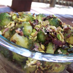 Caramelized Brussels Sprouts with Pistachios Recipe - Caramelizing  is a delicious treatment for the often maligned Brussels sprout.  The onion and vinegar add bite, while the pistachios add crunch.