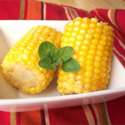 Tasty BBQ Corn on the Cob Recipe - This recipe is for hot, buttery and spicy corn. Corn on the cob is covered with a spicy herb butter, wrapped in foil, and cooked on the grill.