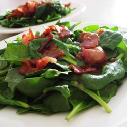Hot Bacon Dressing Recipe - This warm dressing immerses crunchy bacon bits in a sweet, thickened vinaigrette for an old-time taste treat!