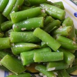 Green Beans with Anchovies Recipe - Frozen green beans are cooked with lemon juice and garlic, and tossed with anchovy fillets. This lively side dish will perk up any meal!