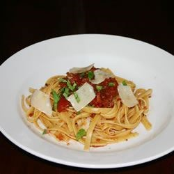 Arrabbiata Sauce Recipe and Video - A sizeable jolt of crushed red pepper revs up this quick and easy tomato sauce.