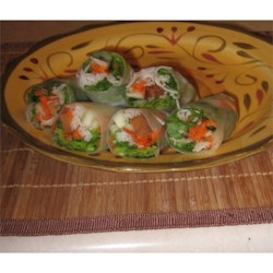 Vietnamese Salad Rolls Recipe - A nice light appetizer. Delicate rice wrappers are filled with noodles, shrimp, carrots, lettuce and basil. Cooked chicken or beef may be substituted for shrimp.