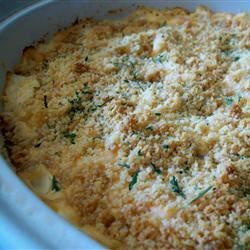 Creamy Dreamy Chicken and Spirals Casserole Recipe - This melt in your mouth casserole is a great comfort dish. The white wine and mustard lend just enough flavor to perk up the cheddar cheese sauce.
