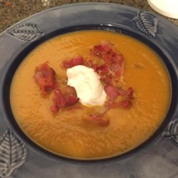 Roasted Butternut Squash Soup with Apples and Bacon Recipe - This curried squash soup has a very creamy consistency but is completely dairy-free except for the optional garnish of sour cream. Roasting the squash adds an extra depth of flavor.