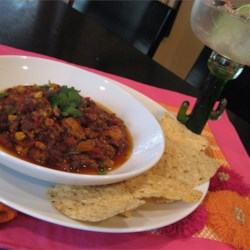 Waistline-Friendly Turkey Chili Recipe - Chipotle barbeque sauce, lime juice, and ground cumin flavor this colorful chili.
