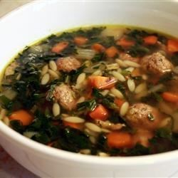 Italian Wedding Soup I Recipe - Make a little extra to send on the honeymoon!  This lovely soup combines extra lean ground beef made into meatballs with thinly sliced escarole or spinach, orzo macaroni, and finely chopped carrot.