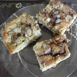 Rhubarb Cake IV Recipe - This is a delightful, lightly spiced rhubarb cake with a spicy almond topping.