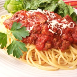 Meat-Lover's Slow Cooker Spaghetti Sauce Recipe - Brown some Italian sausage and ground beef, place in a slow cooker with tomatoes and Italian seasonings, and slow cook it for 8 hours. When you get home, boil up some pasta, and dinner tastes like you slaved all day at the stove.