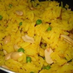 Peanut Rice Recipe - Fragrant basmati rice is cooked with peanuts, green peas, and a little turmeric.