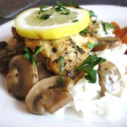 Baked Lemon Chicken with Mushroom Sauce Recipe - Lemon-infused chicken is topped with a creamy mushroom sauce creating a quick and easy weeknight meal.