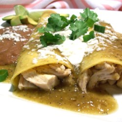 Enchiladas Verdes Recipe - Using a roasted chicken from the grocery saves time in this enchilada recipe with a spicy tomatillo sauce that will have your friends wanting to lick the bowl!