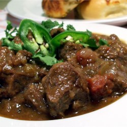 Beef, Green Chili and Tomato Stew Recipe - This hearty stew, flavored with oregano, cumin, and beer, will make your taste buds go into overdrive! Serve over rice or with a crusty bread and salad. Great for a chilly winter meal.