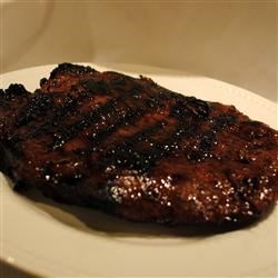 Flank Steak Barbecue Recipe - A soy sauce and honey marinade give this excellent piece of meat a great flavor.